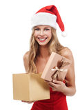 Happy Christmas woman holding gift Stock Photo