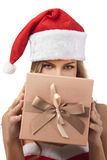 Happy Christmas woman holding gift Royalty Free Stock Images