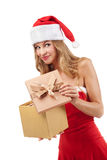Happy Christmas woman holding gift Stock Photos