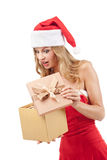 Happy Christmas woman holding gift Stock Images