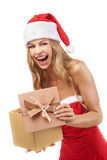 Happy Christmas woman holding gift Royalty Free Stock Image