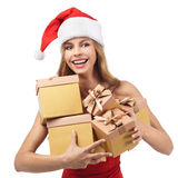 Happy Christmas woman holding gifts Stock Photography