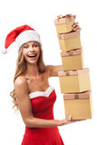 Happy Christmas woman holding gifts Royalty Free Stock Photos