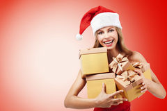 Happy Christmas woman holding gifts Stock Image