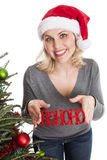 Happy Christmas woman holding ornament Royalty Free Stock Photo