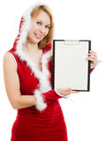 Happy Christmas woman holds a white billboard Royalty Free Stock Photography