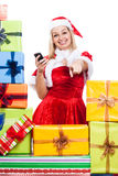 Happy Christmas woman with phone pointing Royalty Free Stock Photography
