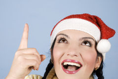 Happy Christmas woman pointing up. Head shot of happy surprised young Christmas woman pointing  and looking up to  to copy space on blue background,check also Stock Images