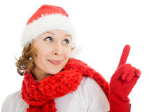Happy Christmas woman points a finger upward Royalty Free Stock Image