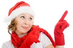 Happy Christmas woman points a finger upward Stock Photo