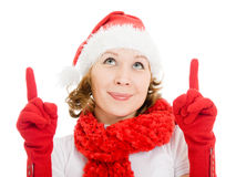 Happy Christmas woman points a finger upward Royalty Free Stock Photography