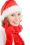 Happy Christmas woman points a finger upward Royalty Free Stock Images