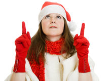 Happy Christmas woman points a finger upward Stock Images