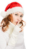 Happy Christmas woman points to the silence Royalty Free Stock Images