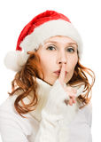 Happy Christmas woman points to the silence Stock Photography