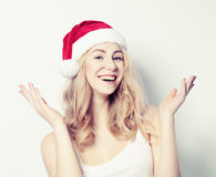 Happy Christmas Woman in Santa Hat Stock Photography