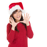 Happy Christmas woman say hello. Happy Christmas woman excited say hello isolated on white background wearing red Santa hat. Beautiful Asian model Royalty Free Stock Images