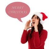 Happy Christmas woman shouting. Excited isolated on white background wearing red Santa hat. Beautiful Asian model Royalty Free Stock Images