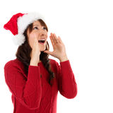Happy Christmas woman shouting excited. Isolated on white background wearing red Santa hat. Beautiful Asian model Stock Photography