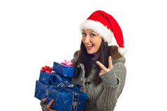 Happy Christmas woman showing victory sign. Happy Christmas woman with gifts showing victory sign isolated on white background Royalty Free Stock Image