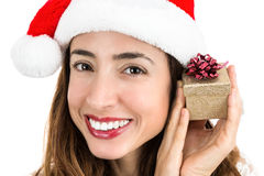 Happy christmas woman with a small gift box in her hand Royalty Free Stock Image