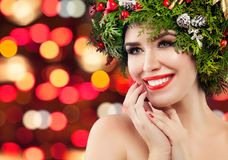 Happy Christmas woman smiling on bright bokeh sparkle background royalty free stock photo