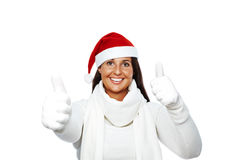 Happy christmas woman success. Young woman with santa hat showing thumbs up for christmas Royalty Free Stock Photography