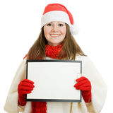 Happy Christmas woman with tablet in hand Royalty Free Stock Image