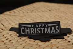 Happy Christmas Word on Black Paper Card Royalty Free Stock Photo