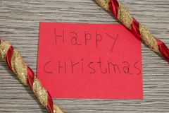 Happy christmas write on a red paper with decorations stock photos