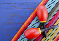 Happy Cinco de Mayo background. With colorful maracas on Mexican theme dark blue distressed table with copy space Royalty Free Stock Image