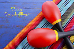 Happy Cinco de Mayo background. With colorful maracas on Mexican theme dark blue distressed table with copy space Stock Photography