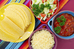 Happy Cinco de Mayo bright colorful party. With ingredients for assembling tacos on festive red wood table