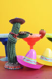 Happy Cinco de Mayo colorful party theme. With bright color margarita drinks on red wood table and yellow background Stock Images