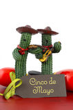 Happy Cinco de Mayo concept. With fun Mariachi Band Cactus players and greeting card on red wood table Stock Photography