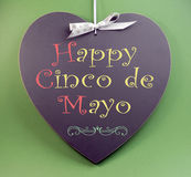 Happy Cinco de Mayo, 5th May, event reminder handwriting greeting on heart shaped blackboard. With sample text on green background Stock Photography