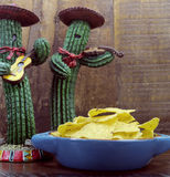 Happy Cinco de Mayo, 5th May, party celebration with fun Mexican cactus and corn chips. Against retro dark wood background