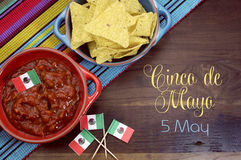 Happy Cinco de Mayo, 5th May, party table celebration. With corn chips and salsa dip, mexican flags and sample text or copy space. for your text here stock photo