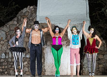 Happy Cirque Clowns on Stage. Group of happy cirque clowns holding hands Royalty Free Stock Image