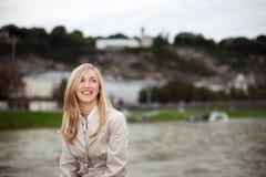 Happy city girl in a stylish coat Royalty Free Stock Photo