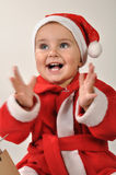 Happy clapping baby girl Stock Photos
