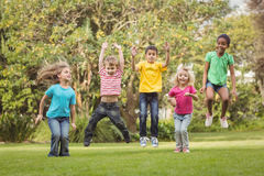 Happy classmates jumping in the air Royalty Free Stock Images