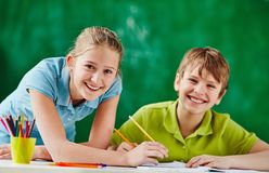 Happy classmates at lesson Stock Images