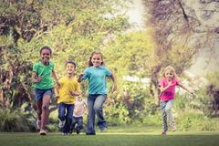 Happy classmates running around Royalty Free Stock Photo
