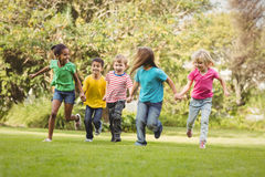 Happy classmates running and holding hands Royalty Free Stock Photography