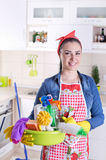 Happy cleaning lady in kitchen Stock Photography
