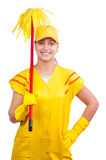 Happy cleaning lady in uniform wearing gloves Stock Photography