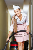 Happy cleaning lady with vacuum cleaner Stock Photos