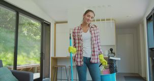 Happy cleaning service employee ready to start working, positive work attitude. Happy cleaning service employee ready to start working, positive work attitude stock footage