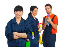 Happy cleaning service team. Happy cleaning service woman and her team isolated on white background Stock Photos